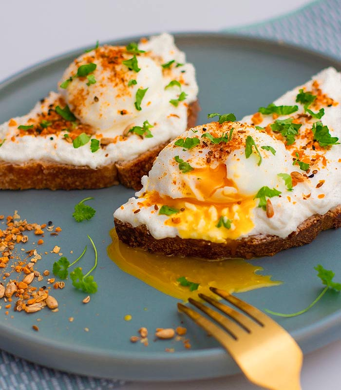whipped feta on sourdough poached eggs